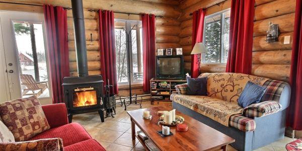 Salon avec poêle à bois - Chalet Nordet