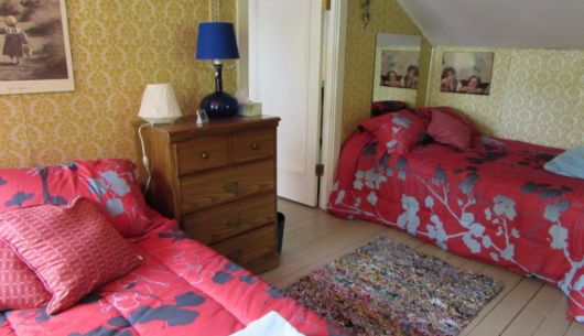 Première chambre à l'étage avec deux lits double