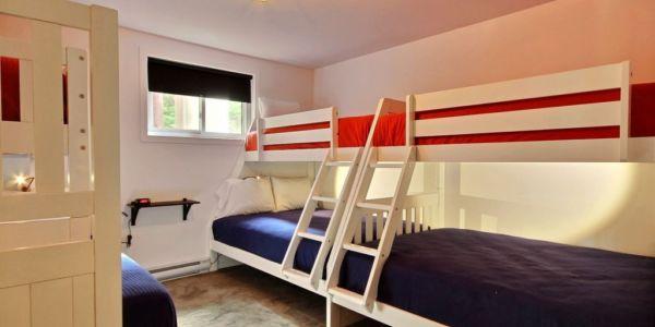 Chambre au sous-sol - Chalet Calumet