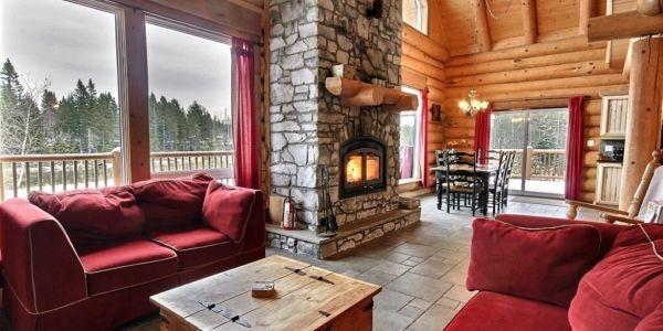 Salon avec foyer de pierre - Chalet Eider